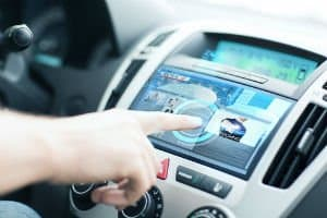 Our Colorado car accident attorneys how in-car entertainment worsens distracted driving.