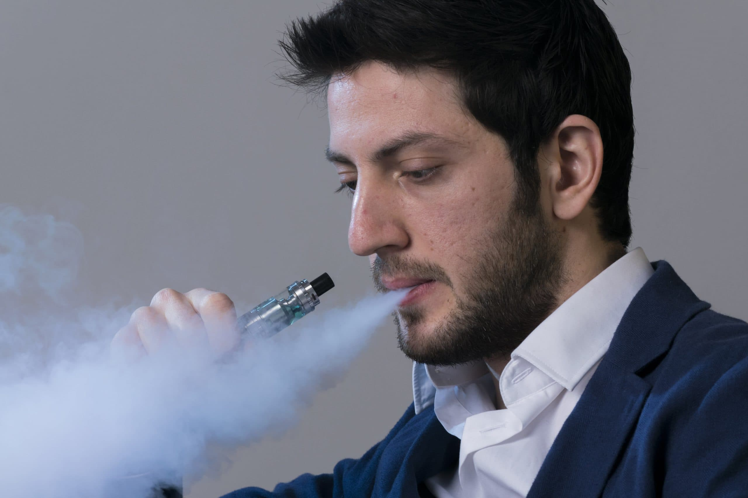Man holding his electronic cigarette.