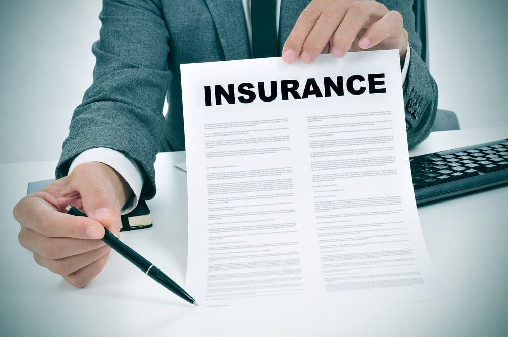 Insurance agent inviting to sign the insurance agreement.
