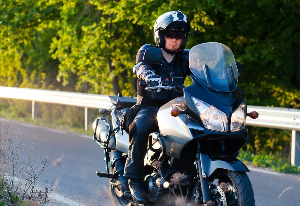 Motorcycle rider wearing safety gear.